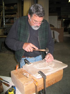 Bill carving open lotus blossom for credenza.