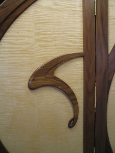 A detail of the black walnut carving on the front of the Art Nouveau screen.