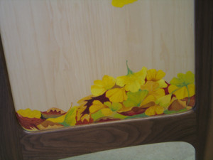 A pile of fallen leaves on the reverse side of the panel.